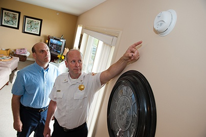 fire official points to smoke alarm