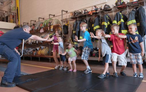 Fire service official teaching children